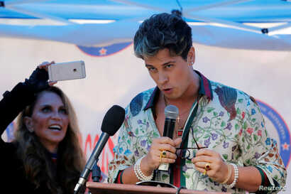 Milo Yiannopoulos speaks to a group protesting against CUNY's decision to allow Linda Sarsour, a liberal Palestinian-American political activist, to speak at commencement in New York, May 25, 2017.