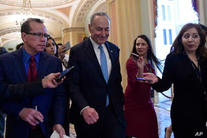 Senate Minority Leader Sen. Chuck Schumer of N.Y., is followed by reporters as he returns to Capitol Hill in Washington, Jan. 4, 2019, following a meeting at the White House with President Donald Trump.
