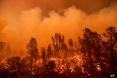 The Carr Fire burns along Highway 299 in Redding, Calif., July 26, 2018.