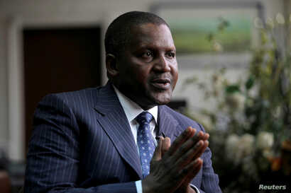 Aliko Dangote , founder and CEO of the Dangote Group, gestures during an interview in his office in Lagos, Nigeria, June 13, 2012.