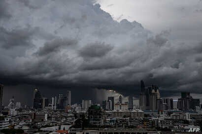 Heavy rain clouds move over the central business district in Bangkok.