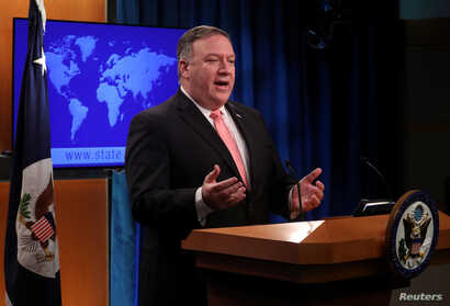 U.S. Secretary of State Mike Pompeo speaks to reporters during a news briefing at the State Department in Washington, Oct. 23, 2018.
