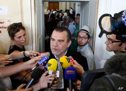 FILE - French lawyer, Franck Berton,  answering questions to the media at the Douai courthouse, northern France.