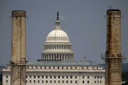 FILE- The Capitol dome is seen behind the Capitol Power Plant in Washington in a June 24, 2013, photo.