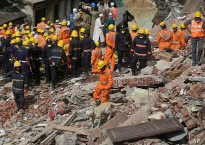 Rescuers work at the site of a building collapse in Mumbai, India, Aug. 31, 2017.