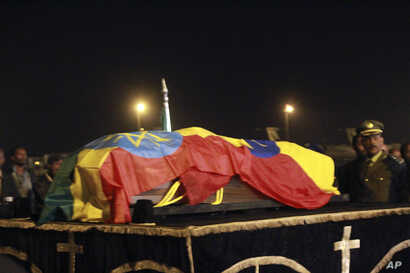 The casket containing the body of Meles Zenawi arrives at the Addis Ababa International Airport, Ethiopia, August 22, 2012.