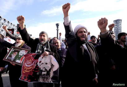 Iranian protesters chant slogans during a demonstration condemning the execution of Shi'ite cleric Sheikh Nimr al-Nimr in Saudi Arabia, at Imam Hussein Square, in Tehran, Jan. 4, 2016.