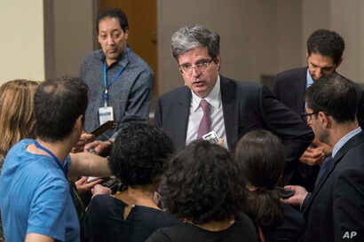 French Ambassador Francois Delattre speaks to reporters as he arrives for a Security Council meeting, July 24, 2017, at U.N. headquarters.