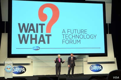 DARPA director Arati Prabhakar, left, and Defense Secretary Ash Carter welcome visitors at the opening of a conference aimed at highlighting innovative technologies and fostering an interdisciplinary approach to problem-solving. (Credit: Art Chimes/V...