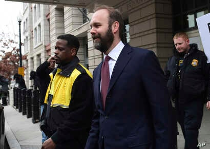 Rick Gates leaves federal court in Washington, Feb. 23, 2018. Gates is a former top adviser to President Donald Trump's election campaign.