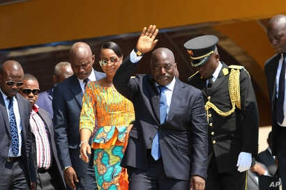 FILE - Democratic Republic of Congo President Joseph Kabila, center, waves as he and others celebrate the DRC's independence day, in Kindu, DRC, June 30, 2016. Under the DRC's constitution, Kabila should step down when his second term expires in Dece...