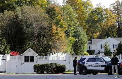 Police officers stand in front of property owned by former Secretary of State Hillary Clinton and former President Bill Clinton in Chappaqua, N.Y., Oct. 24, 2018.