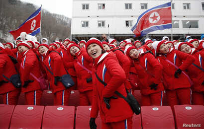 North Korean cheerleaders at a downhill skiing event at the Pyeongchang 2018 Winter Olympics on February 14, 2018.