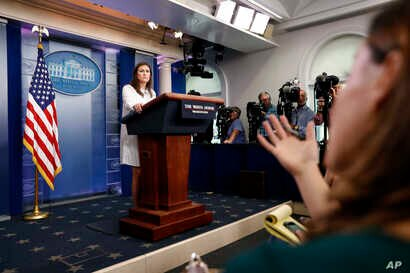 Hallie Jackson, right, NBC's Chief White House correspondent, asks a question of White House press secretary Sarah Huckabee Sanders during a press briefing at the White House, Sept. 12, 2017.