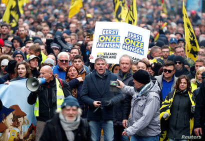 FILE - Flemish right-wing party President Filip Dewinter attends a protest against Marrakesh Migration Pact in Brussels, Belgium, Dec. 16, 2018.