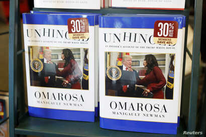 """The book """"Unhinged,"""" by former White House staffer Omarosa Manigault Newman on her time in the White House administration, is seen for sale in Manhattan, New York, Aug. 14, 2018."""