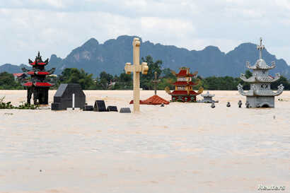 Submerged tombs are seen at a flooded village after heavy rainfall caused by tropical storm Son Tinh in Ninh Binh province, Vietnam, July 22, 2018.