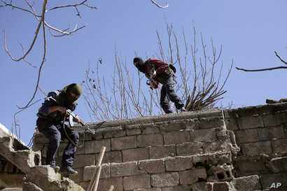 FILE - Militants from the Kurdistan Workers Party, or PKK, run as they attack Turkish security forces in Nusaydin, Turkey, March 1, 2016. PKK rebels are suspected to be behind the latest attack in Diyarbakir province.