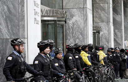Chicago police block the main entance to Water Tower Place during a protest march against police violence in Chicago, Illinois, Dec. 24, 2015.