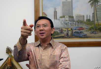 Jakarta vice governor Basuki Tjahaja Purnama, known by his nickname Ahok, speaks to journalists at his office in Jakarta, August 14, 2014.