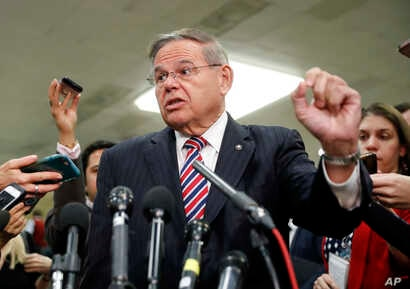 Sen. Bob Menendez, D-N.J., speaks to members of the media after leaving a closed door meeting about Saudi Arabia with Secretary of State Mike Pompeo, Nov. 28, 2018, on Capitol Hill in Washington.