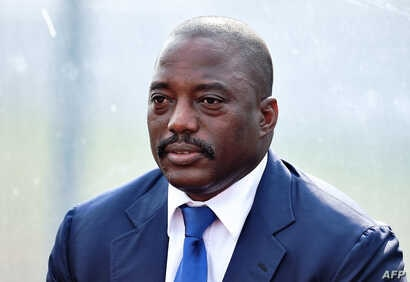 This file photo taken on February 3, 2015 shows the Democratic Republic of the Congo's President Joseph Kabila attending a training session of his country's football team in Bata.