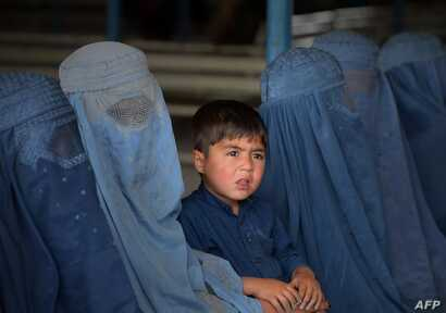 Afghan refugee families wait to be registered at the United Nations High Commissioner for Refugees (UNHCR) repatriation center on the outskirts of Peshawar.