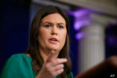 White House press secretary Sarah Huckabee Sanders talks to reporters during a press briefing in the Brady press briefing room at the White House in Washington, Oct. 29, 2018.