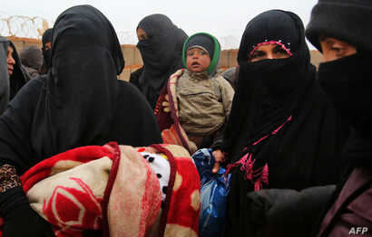 FILE - Syrian refugees are seen at Rukban camp, located in a no-man's-land on the border between Syria and Jordan, March 1, 2017.