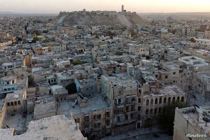 FILE - A general view taken with a drone shows Aleppo's historic citadel, controlled by forces loyal to Syria's President Bashar al-Assad, as seen from a rebel-held area of Aleppo, Syria.