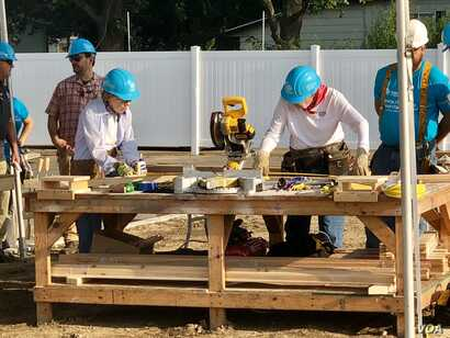 Former President Jimmy Carter and first lady Rosalyn Carter work on a Habitat for Humanity home for Ericka Santiestepan and her two young children in Mishawaka, Ind.