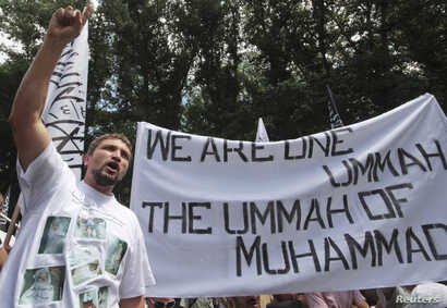 FILE - A supporter of the Islamist Hizb ut-Tahrir movement attends a rally in Simferopol, the administrative center of Crimea in southern Ukraine, June 6, 2013.