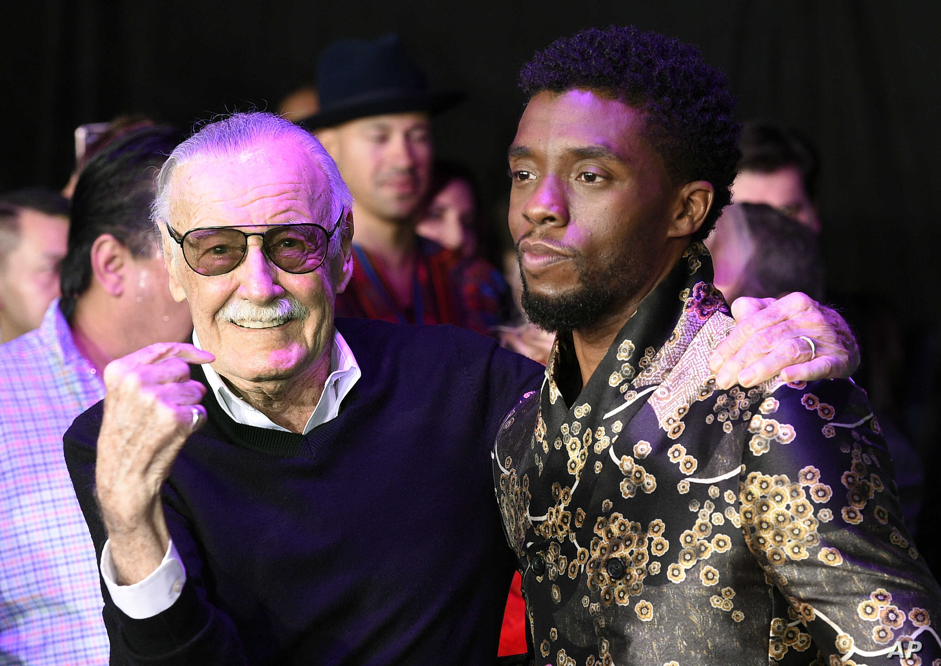 """FILE - Comic book legend Stan Lee (L), creator of the """"Black Panther"""" superhero, poses with Chadwick Boseman, star of the new """"Black Panther"""" film, at the premiere at The Dolby Theatre in Los Angeles, Jan. 29, 2018."""