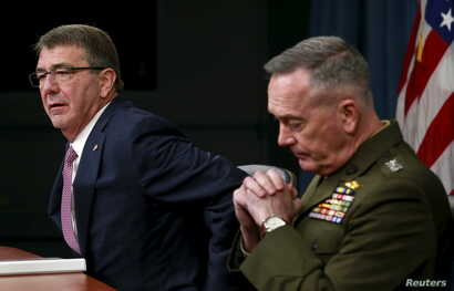 """U.S. Defense Secretary Ash Carter, left, and Joint Chiefs Chairman Marine Gen. Joseph Dunford speak at the Pentagon in Washington, Feb. 29, 2016. Carter said the Syrian cease-fire, if """"properly adhered to,"""" could lead to a decline in violence."""