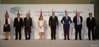 Family photo during a G7 for foreign ministers in Lucca, Italy, April 11, 2017.