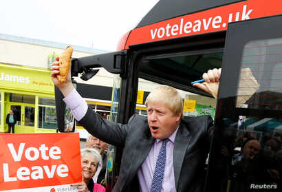 Former London Mayor Boris Johnson holds up a Cornish pasty during the launch of the Vote Leave bus campaign, in favor of Britain's exit from the European Union, in Truro, England, May 11, 2016.
