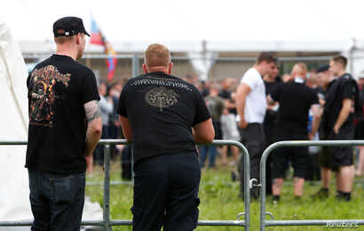 FILE - Participants arrive for one of Germany's biggest right-wing music festivals in Themar, Germany, July 15, 2017.