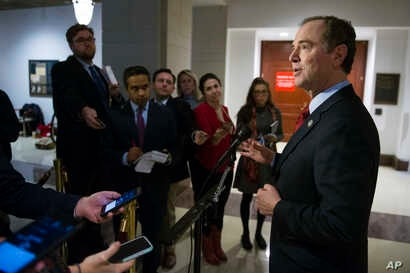 Rep. Adam Schiff of Calofornia, the ranking Democrat on the House Intelligence Committee's Russia investigation, speaks to reporters, on Capitol Hill in Washington, during a break in the committee's questioning of President Donald Trump's former camp...