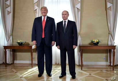 U.S. President Donald Trump and Russian President Vladimir Putin, right, pose for a photograph at the Presidential Palace in Helsinki, Finland, July 16, 2018 prior to Trump's and Putin's one-on-one meeting in the Finnish capital.