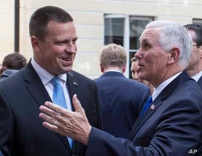 U.S. Vice President Mike Pence, right, and Estonia's Prime Minister Juri Ratas speak prior to their meeting at the Stenbocki house in Tallinn, Estonia, Sunday, July 30, 2017. Pence arrived in Tallinn for a two day visit where he will meet Baltic Stat...