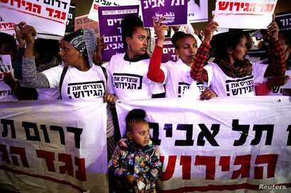 FILE - People take part in a protest against the Israeli government's plan to deport African migrants, in Tel Aviv, March 24, 2018.