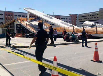 Emergency personnel work at the scene of a collapsed pedestrian bridge at Florida International University on March 15, 2018, in the Miami area.