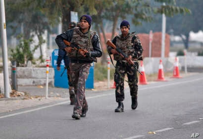 Indian security forces patrol inside the Indian air force base that came under attack Saturday in Pathankot, India, Jan. 3, 2016.