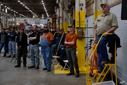 Workers listen as President Donald Trump delivers remarks at the Lima Army Tank Plant, March 20, 2019, in Lima, Ohio.