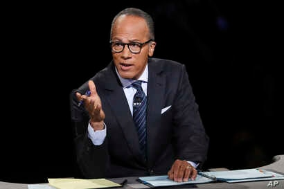 FILE - Moderator Lester Holt, anchor of NBC Nightly News, asks a question during the presidential debate at Hofstra University in Hempstead, N.Y., Sept. 26, 2016. Holt says his trip to North Korea was valuable despite restrictions placed upon him by ...