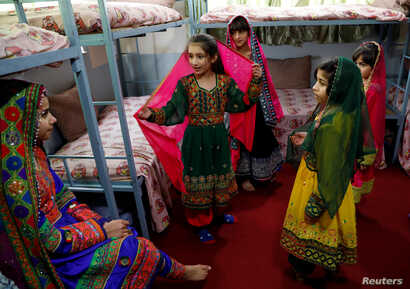 Afghan girls chat to each others at an Afghan Child Education and Care Organization center (AFCECO) in Kabul, Afghanistan March 3, 2019.