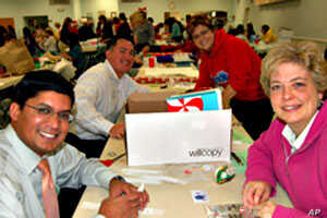 Dozens of volunteers helped wrap the gifts