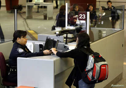 Visa A foreign airline passenger is greeted by a Customs and Border Protection Officer
