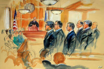 This courtroom sketch depicts Paul Manafort, fourth from right, standing with his lawyers in front of U.S. district Judge T.S. Ellis III, center rear, and the selected jury, seated left, during the jury selection of his trial at the Alexandria Federa