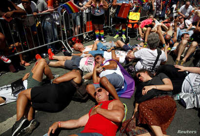 "Members of ""Gays Against Guns"" hold a 'die-in' during the annual NYC Pride parade in New York City, New York, U.S., June 26, 2016."